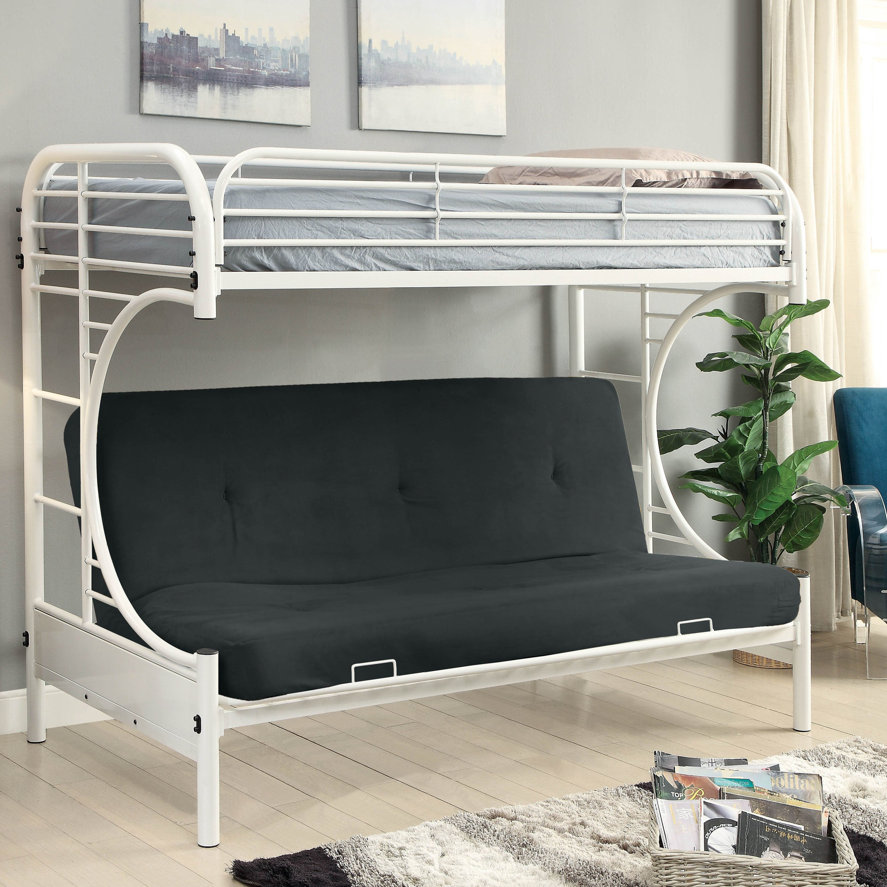 hardwood spring in with comfortable futon futons sleeping offers base sinuous frame blue that space upholstered and seating constructed plush royal or velvet a metal pin