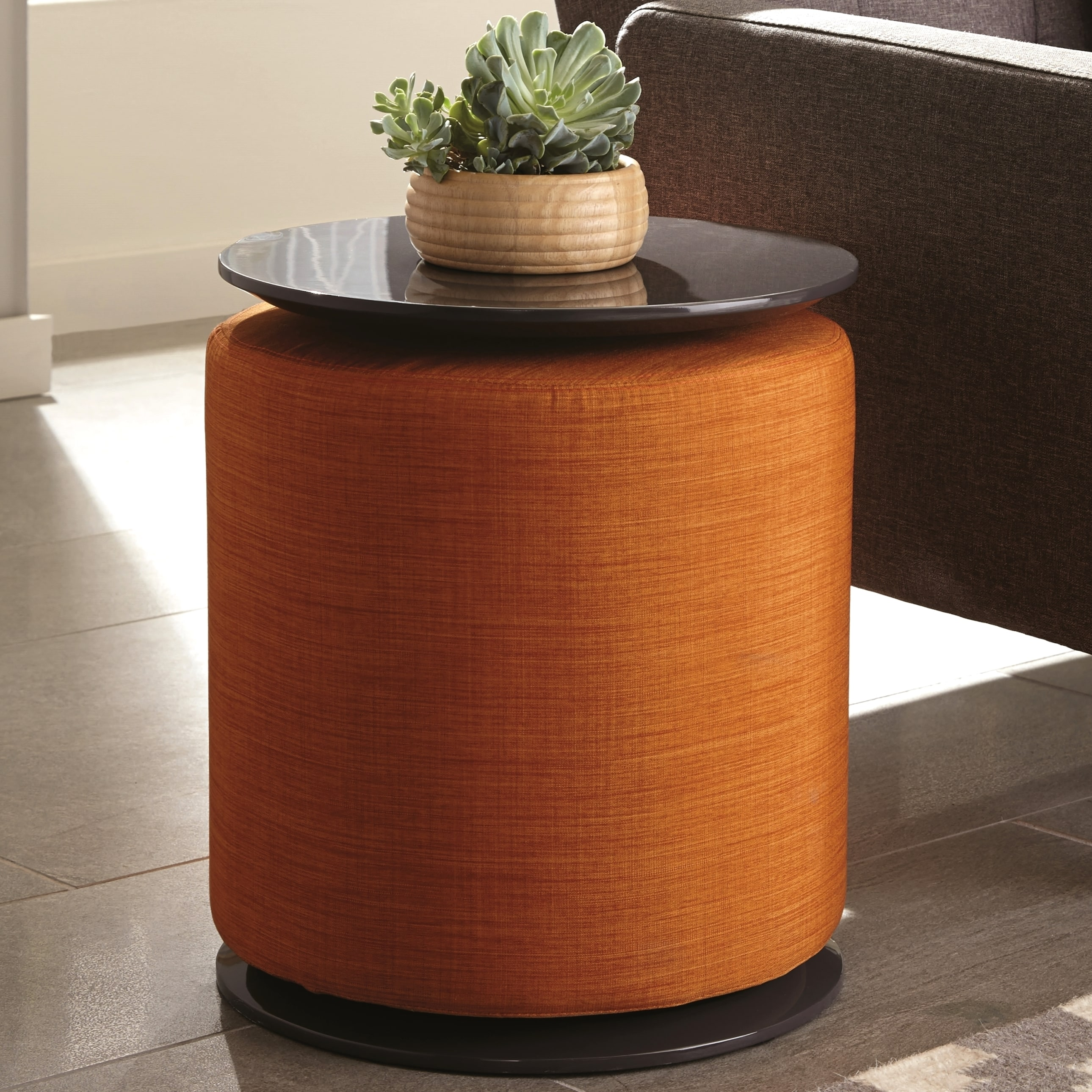 Modern cylinder design accent table with orange ottoman