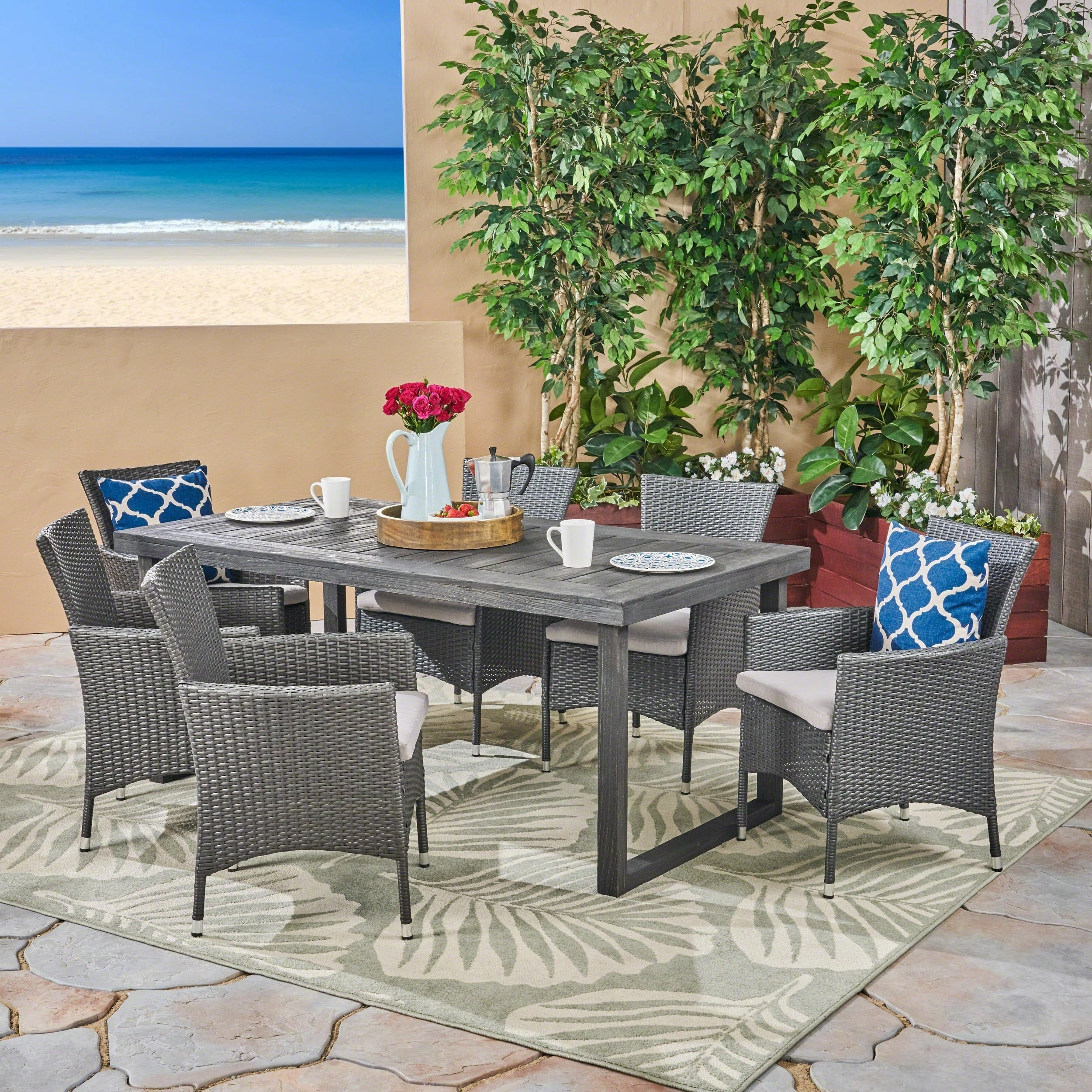 Moralis outdoor 6 seater acacia wood dining set with wicker chairs by christopher knight home