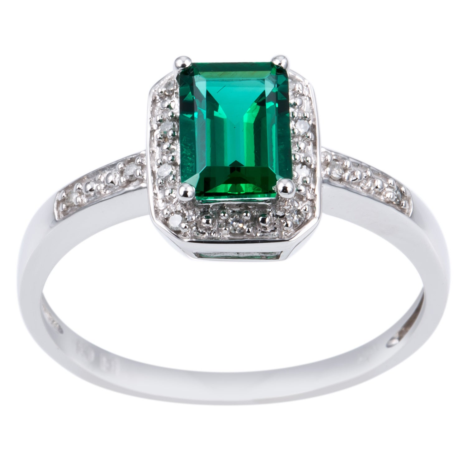 and cut stone center with three uneek green platinum shank ring emerald in pave silhouette