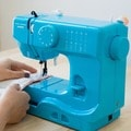 Janome Turbo Teal Basic, Easy-to-Use, 10-stitch Portable, 5 lb Compact Sewing Machine with Free Arm