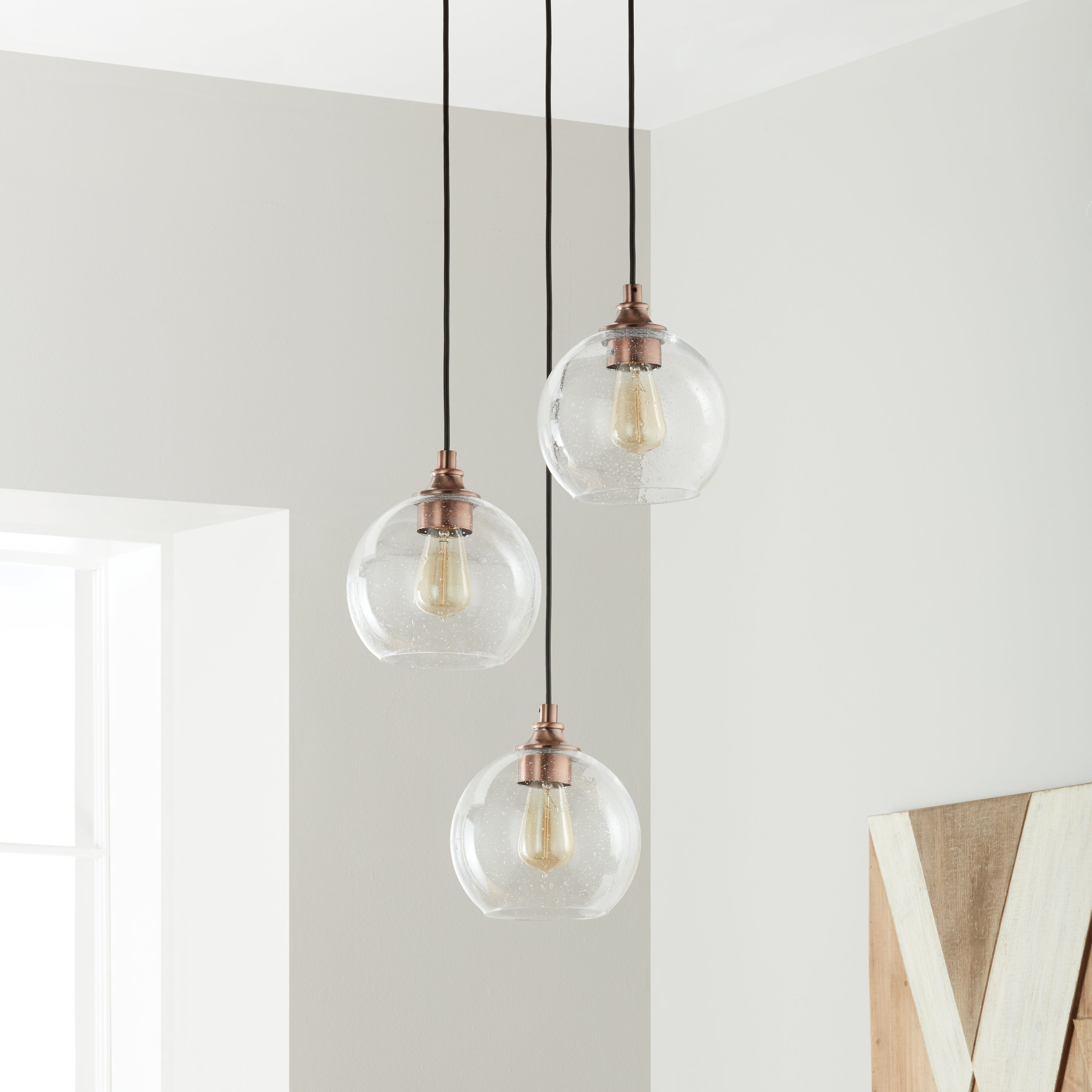 Shop Uptown Clear Globe Cluster Copper 3-light Pendant - Free ...