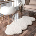 nuLOOM Handmade Faux Sheepskin One and a Half Piece Natural shag Rug (2' x 4'5)