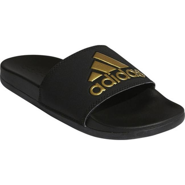 7a0c56050f9c adidas Women s Adilette Cloudfoam PLus Logo Slide Sandal Core Black Gold  Met Core Black