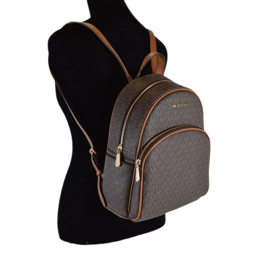 fa86fcfbd66 Shop Michael Kors Brown Acorn Coated Canvas Signature Abbey Backpack Bag -  12