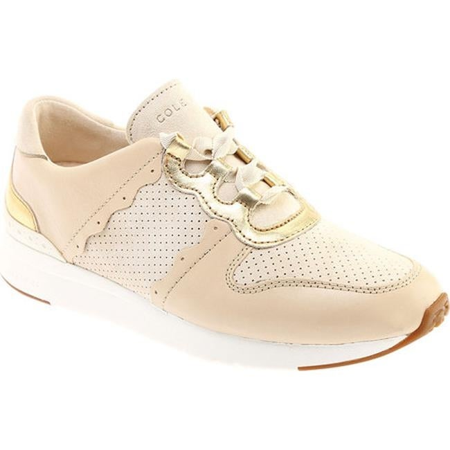 Cole Haan Women s Grandpro Wedge Sneaker Sandshell Leather Kid Suede CH Gold Optic  White