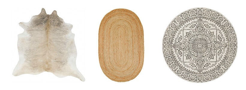 Three different shaped rugs featuring a cowhide nautral skin rug, a round sukha polypropylene rug, and a oval jute rug