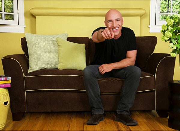 Angelo Surmelis and a sofa of his own design