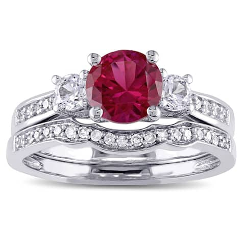 Miadora 10k White Gold Created Ruby and White Sapphire and 1/6ct TDW Diamond 3-stone Bridal Ring Set