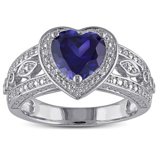 Miadora Sterling Silver Created Blue Sapphire and 1/10ct TDW Diamond Heart Halo Ring