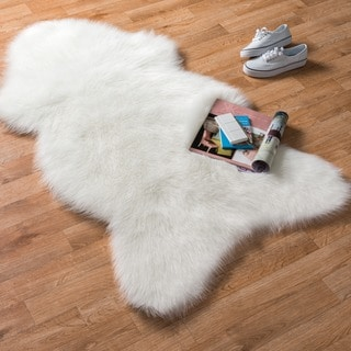Link to Alexander Home Asher Faux Fur Sheepskin Area Rug Similar Items in Rugs