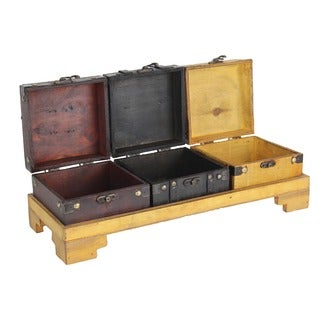 Three Colored Wooden Treasure Chests on Tray