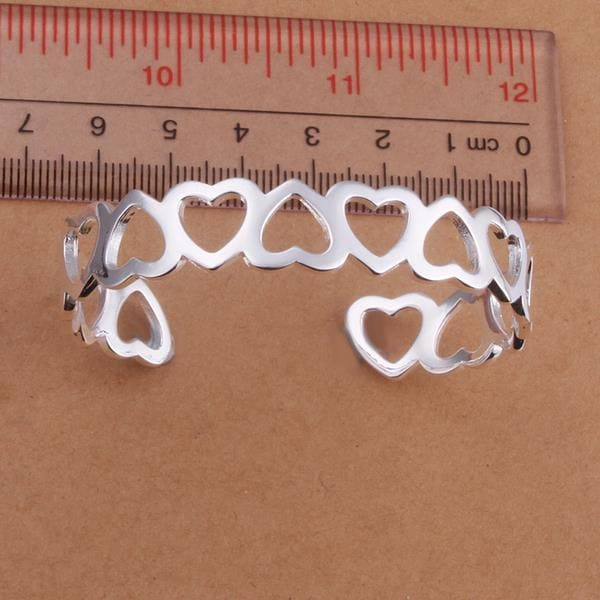 Sterling Silver Hollow Hearts Open Bangle