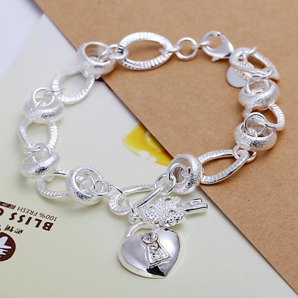Vienna Jewelry Sterling Silver Petite Heart Emblem Modern Bracelet