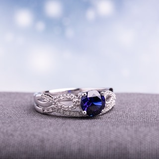 Miadora 10k White Gold Created Blue Sapphire and 1/6ct TDW Diamond Bridal Ring Set (G-H, I1-I2)