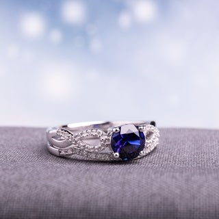 Miadora 10k White Gold Created Blue Sapphire and 1/6ct TDW Diamond Bridal Ring Set
