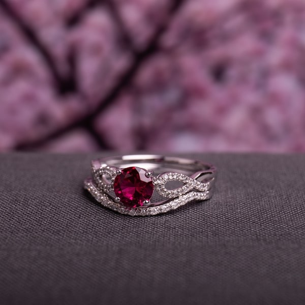 Miadora 10k White Gold Created Ruby and 1/6ct TDW Diamond Bridal Ring Set. Opens flyout.