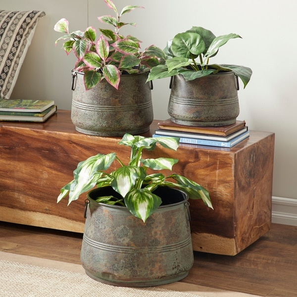 Set of 3 Rustic 8, 9, and 11 Inch Round Metal Planters by Studio 350. Opens flyout.