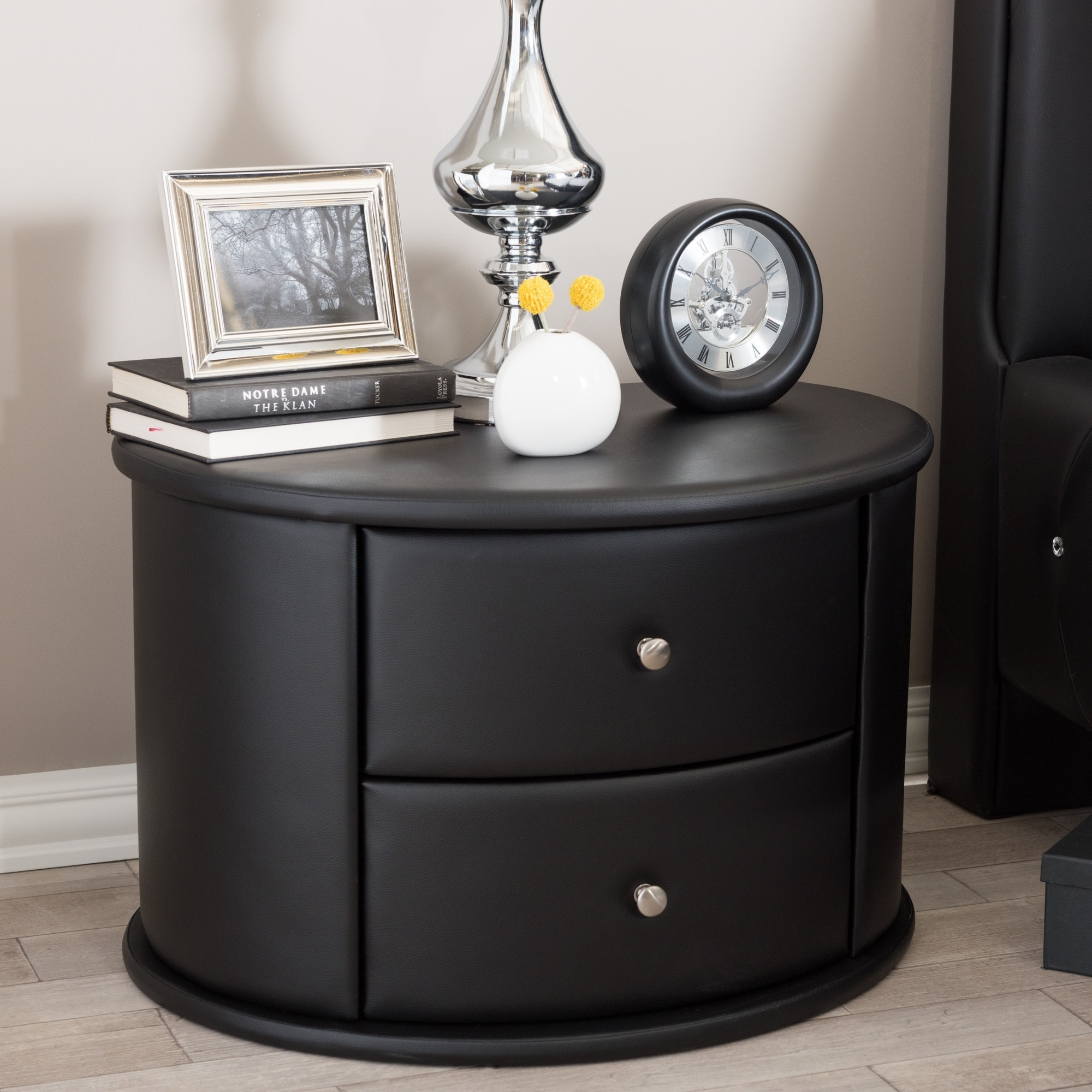 Baxton Studio Ritchie Black Faux Leather Oval Upholstered Modern Nightstand