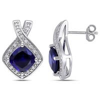 Miadora Sterling Silver Created Blue Sapphire and 1/5ct TDW Diamond Birthstone Crossover Halo Earrings
