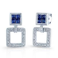 Estie G 18k White Gold Blue Sapphire and 1/10ct TDW Diamond Earrings (H-I, VS1-VS2)