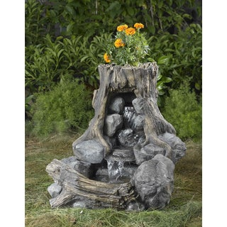 Wood and Rock Fountain with Flower Pot