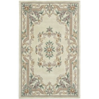 Hand-tufted Floral Ivory Accent Rug (2' x 4')