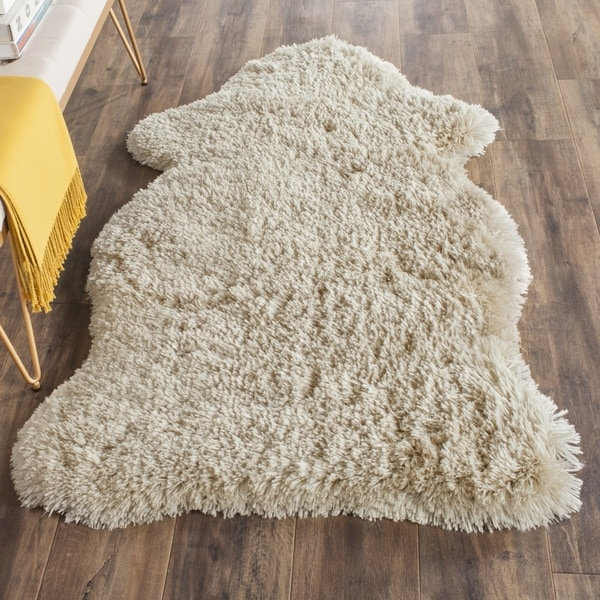 Safavieh Handmade Arctic Shag Beige Polyester Hide Shaped Rug - 5' x 7'