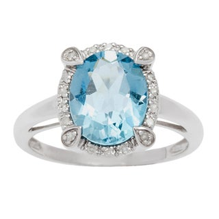 Viducci 10k Gold Oval Blue Topaz and 1/8ct TDW Diamond Halo Ring (G-H, I1-I2)