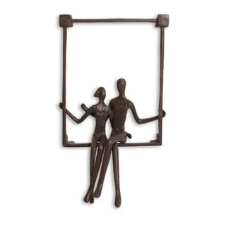 Danya B Couple Sitting on a Window Sill Iron Wall Hanging