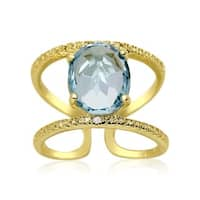 3.40 TGW Blue Topaz and Diamond Open Shank Ring In Yellow Gold Over Sterling Silver
