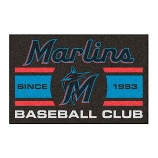 Fanmats Miami Marlins Black Nylon Uniform Inspired Stater Rug (1'6 x 2'5) https://ak1.ostkcdn.com/images/products/10383264/P17488206.jpg?_ostk_perf_=percv&impolicy=medium