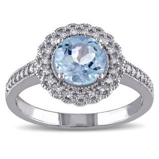 Miadora Sterling Silver Blue Topaz and 1/6ct TDW Diamond Ring (G-H, I2-I3)