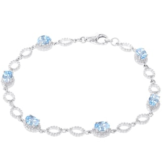H Star 14k White Gold 1/5ct Diamond and Blue Topaz Bracelet (H-I, I1-I2)
