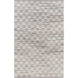 Hand-Woven Raunds Distressed Hair On Hide Rug (2' x 3')