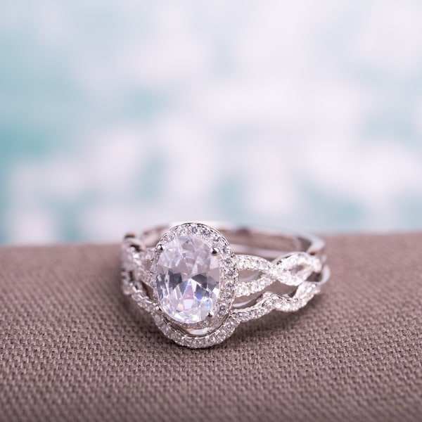 Miadora Sterling Silver Oval and Round-cut Cubic Zirconia Halo Bridal Ring set. Opens flyout.