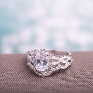 Miadora Sterling Silver Oval and Round-cut Cubic Zirconia Halo Bridal Ring set https://ak1.ostkcdn.com/images/products/10454526/P17547038.jpg?impolicy=medium