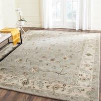 Safavieh Handmade Heritage Timeless Traditional Beige/ Grey Wool Rug - 5' x 8'