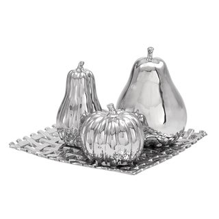 4-piece Silvertone Ceramic Fruit Orbs on a Reflective Tray