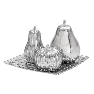 4-piece Silvertone Ceramic Fruit Orbs on a Reflective Tray https://ak1.ostkcdn.com/images/products/10470269/P17560671.jpg?impolicy=medium
