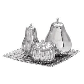4-piece Silvertone Ceramic Fruit Orbs on a Reflective Tray