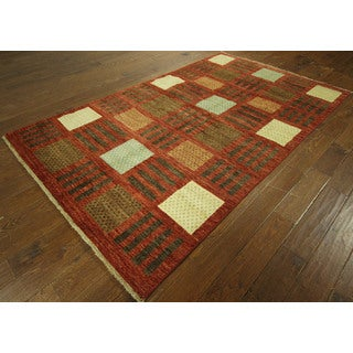 Unique Red Hand-knotted Super Fine Gabbeh Hand-knotted Wool Area Rug (6' x 9')