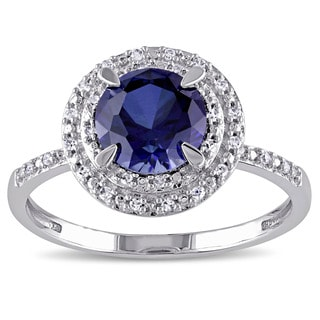 Miadora 10k White Gold Created Blue Sapphire and 1/10ct TDW Diamond Double Halo Ring (G-H, I1-I2)