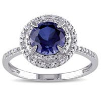 Miadora 10k White Gold Created Blue Sapphire and 1/10ct TDW Diamond Double Halo Ring (G-H, I1-I2)