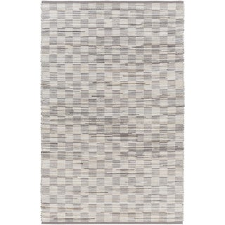 Hand-Woven Raunds Distressed Hair On Hide Rug (5' x 7'6)