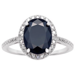 3 1/2 TGW Oval Shape Sapphire and Halo Diamond Ring In Sterling Silver