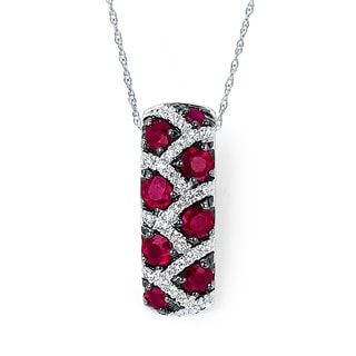 Boston Bay Diamonds 14K Gold 1/6ct TDW Diamond and Ruby Leopard Pendant