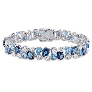 Miadora Signature Collection Sterling Silver Blue Topaz and Created White Sapphire Tennis Bracelet