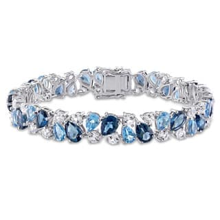 Miadora Signature Collection Sterling Silver Blue Topaz and Created White Sapphire Tennis Bracelet|https://ak1.ostkcdn.com/images/products/10790070/P17837693.jpg?impolicy=medium