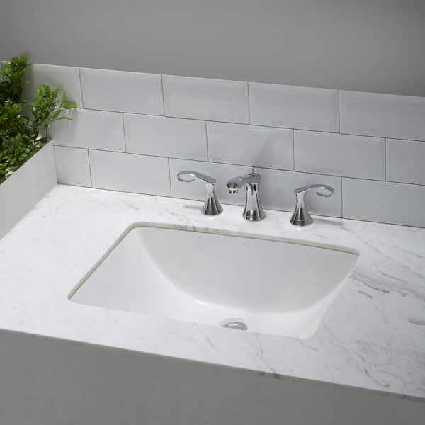 rectangular ceramic undermount bathroom sink in white with overflow